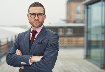 Confident stylish businessman on a balcony