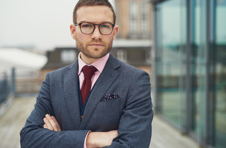 Confident businessman standing outside office