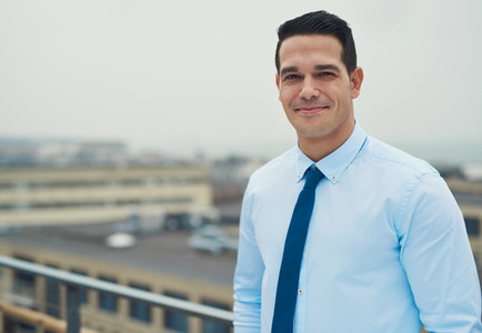 Smiling relaxed Hispanic businessman