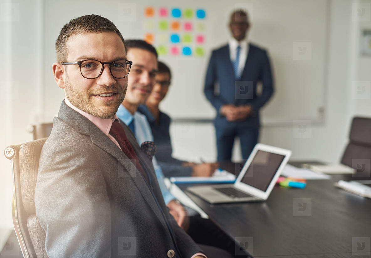 Group of four people in conference meeting