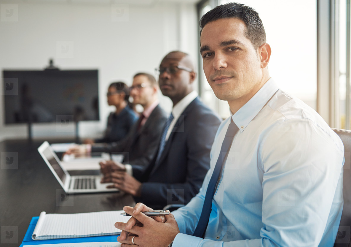 Young Hispanic businessman in a meeting