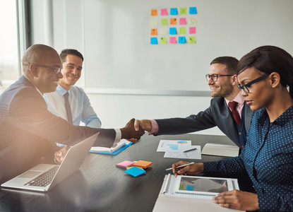 Multiracial team concluding a business agreement