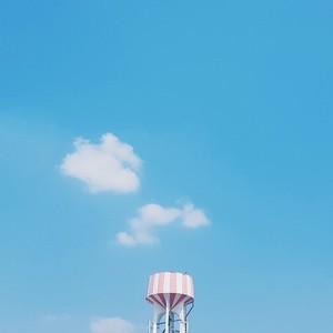 Water tower on blue sky