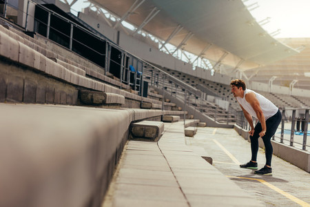 Athlete working out in the stands of a stadium