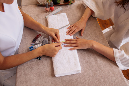 Selection of artificial nails in beauty salon