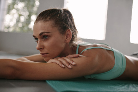 Fit young woman taking rest after workout