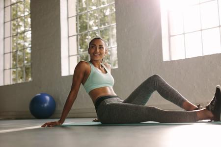 Female taking break after training in gym