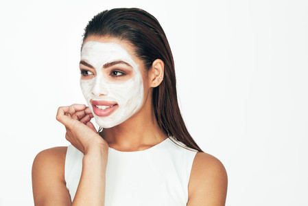 Woman with a cosmetic facial mask
