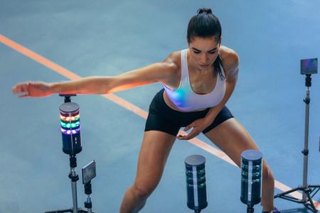 Athlete using visual stimulus system at sports lab