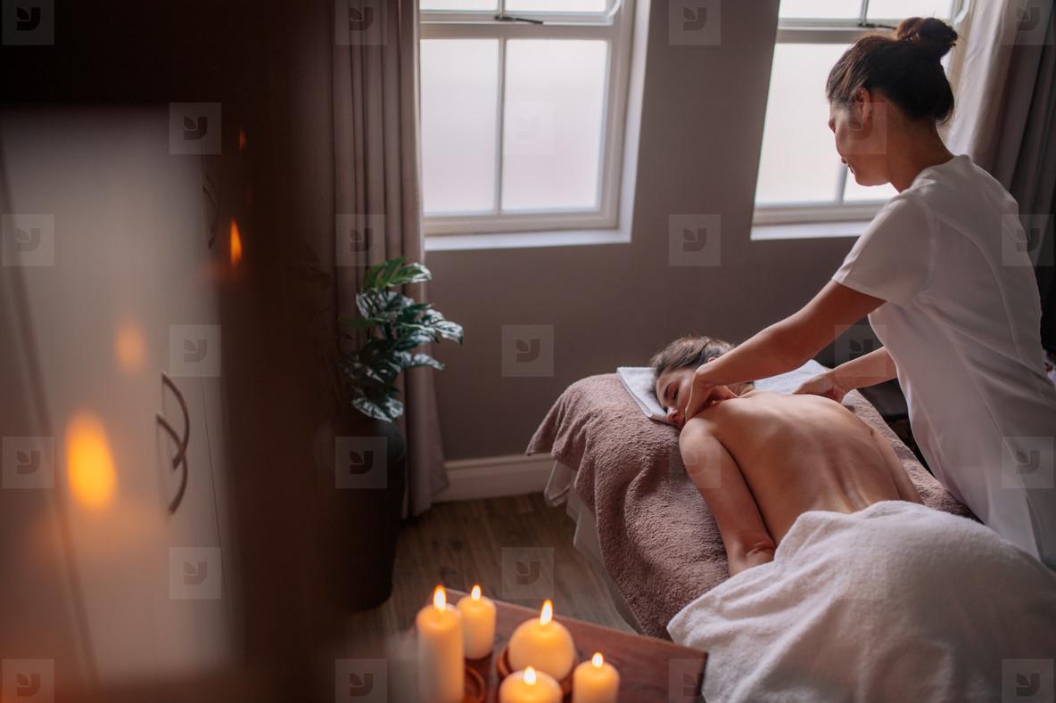 Photos - Woman receiving body massage at spa center 136954 ...
