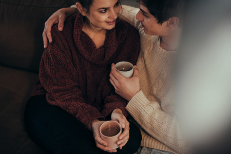 Affectionate couple at home with coffee