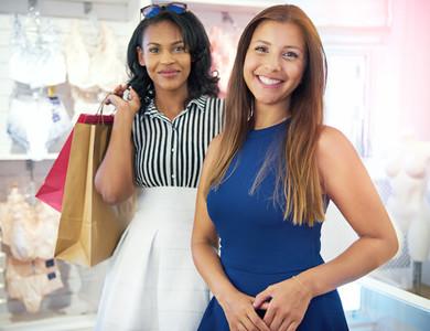 Two multiracial young women shopping