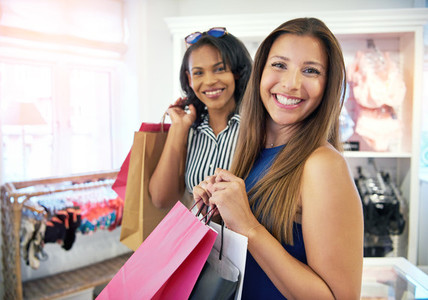 Two happy female friends shopping together