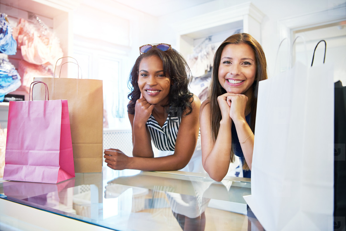 Two attractive female friends shopping together