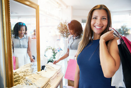 Smiling attractive young woman shopping