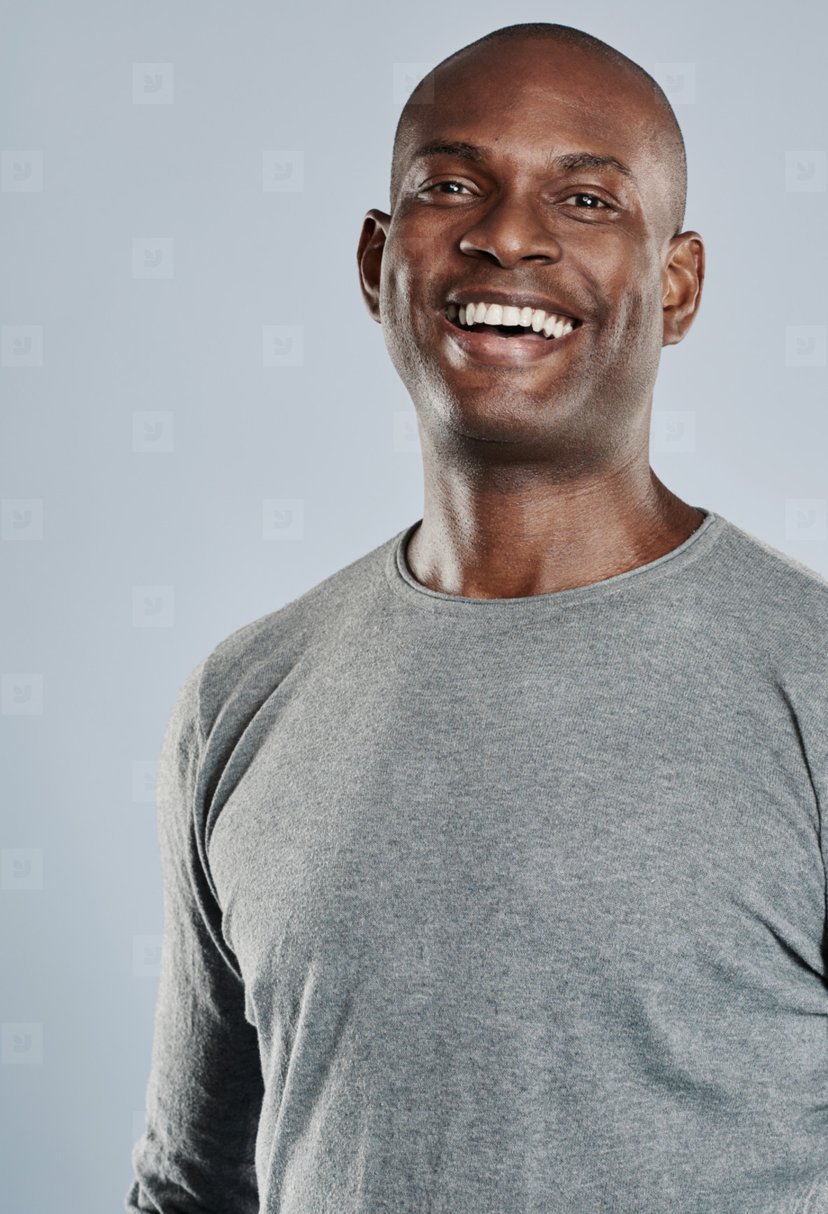 Happy man in gray shirt laughing