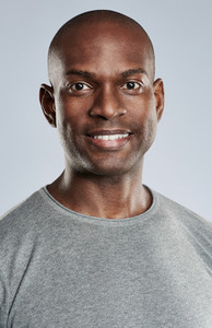 Portrait of attractive happy man in workout shirt