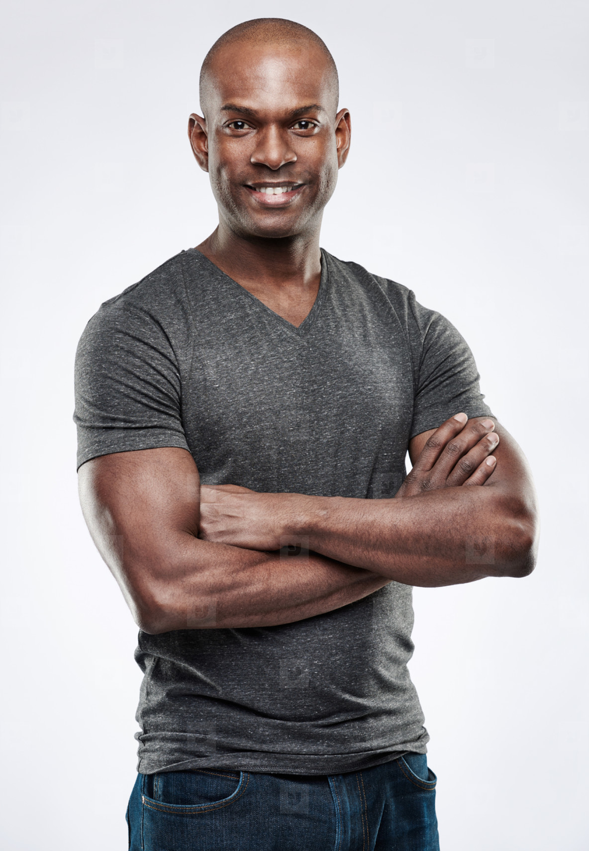 Handsome fit smiling man with folded arms