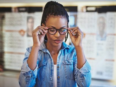 Close up of woman trying out new eyeglasses