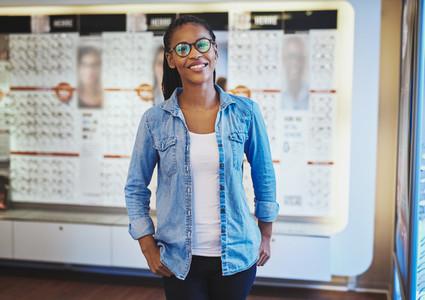 Pretty woman in eyeglasses at eye wear store