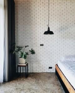 Black lampshade in bedroom
