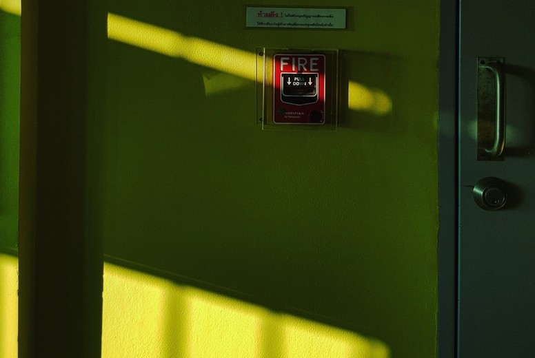 Fire alarm switch in shadow