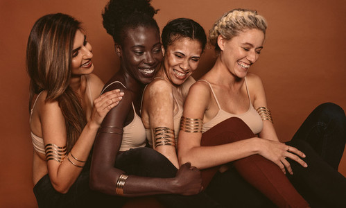 Smiling female models with different skins