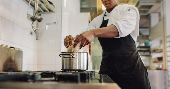 Chef preparing food in restaurant kitchen