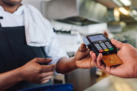 Customer making cashless payment in restaurant