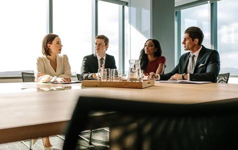 Business people having meeting in a board room