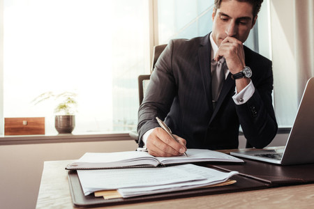 Male entrepreneur working at his desk