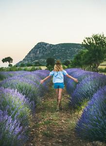 Young blond woman traveller walking in lavender field  Isparta  Turkey