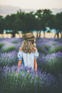 Young blond woman traveller standing in lavender field  Isparta  Turkey