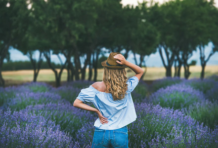 Young woman traveller standing in lavender field  Isparta  Turkey