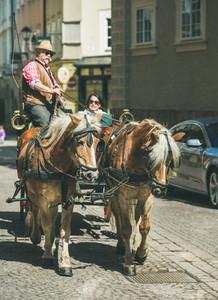 SALZBURG  AUSTRIA   APRIL 09  2017 Horses pulling traditional Fiacre carriage