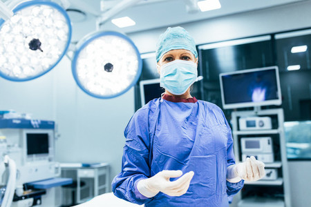 Surgeon in operating room ready to work on patient