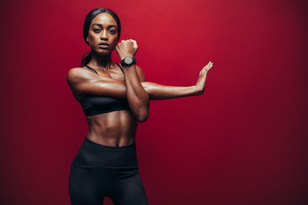 Woman stretching arms for good flexibility of her bicep