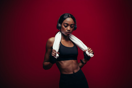 Healthy female athlete relaxing after exercising
