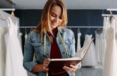 Female bridal store owner with a diary