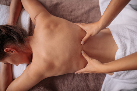 Woman receiving back massage at