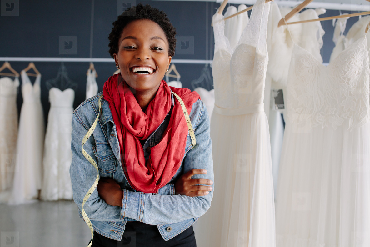 Portrait of smiling bridal store owner