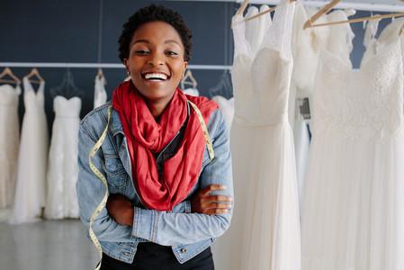 Portrait of smiling bridal store owner