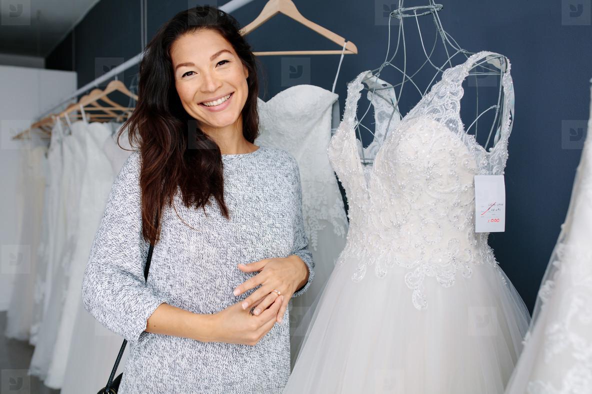 Asian woman shopping for wedding dress
