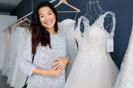 Asian woman shopping for wedding dress