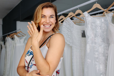 Smiling woman in bridal boutique
