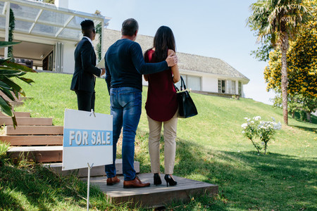 Couple visiting luxury villa with real estate agent