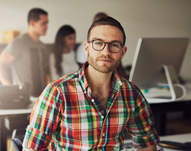 Young businessman wearing glasses in the office