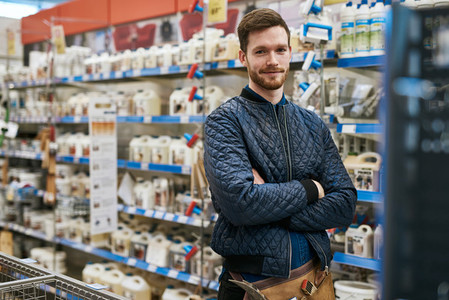 Confident handyman in a hardware store
