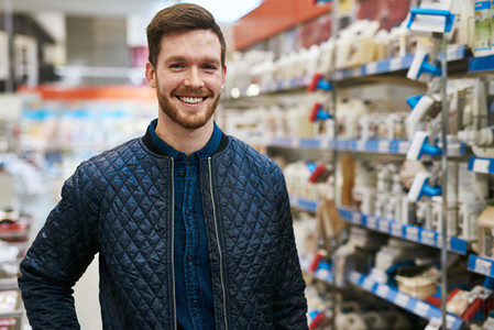 Friendly handsome man in a hardware store