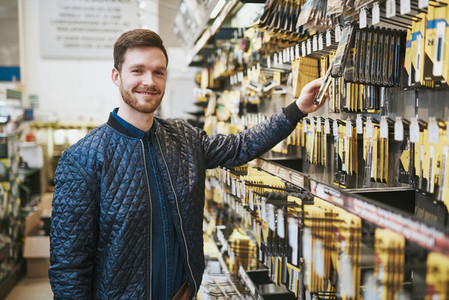Smiling confident customer in a hardware store